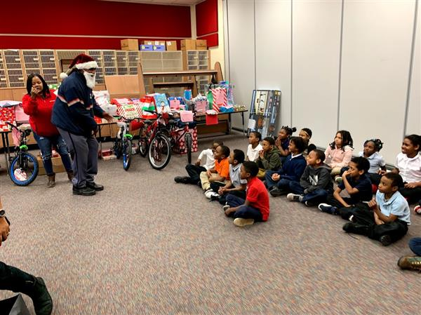 The United Postal Service Brings Gifts to East Clark