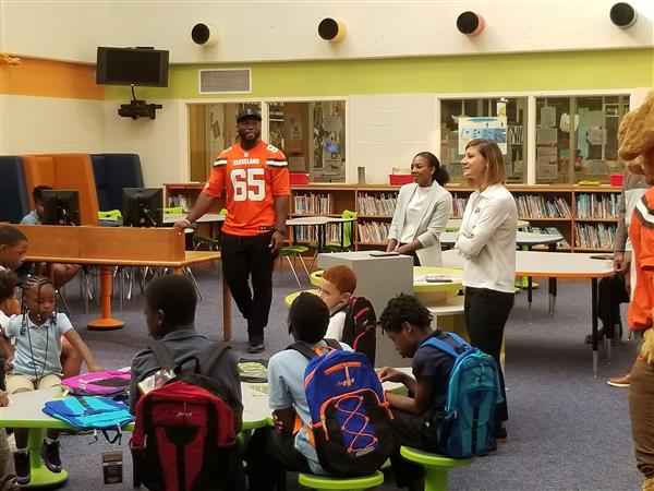 Educational efforts rewarded with Browns visit and backpacks!
