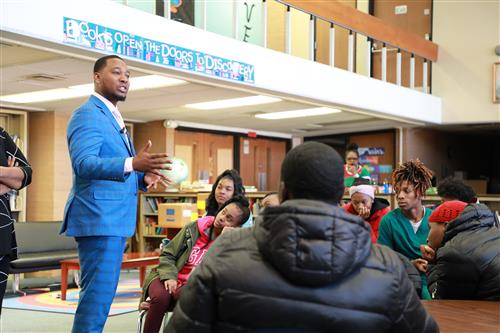 Cleveland City Councilman, Basheer Jones, speaking to seniors at Martin Luther King, Jr., High School