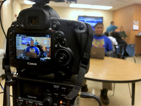 Students create marketing videos for their schools (Video)