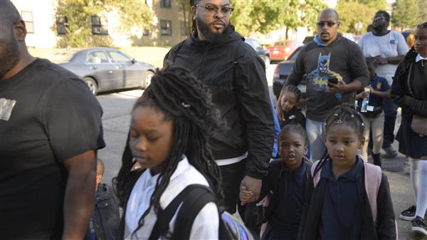 Dike School of the Arts students and their fathers take part in annual walk