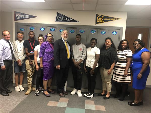 Paolo DeMaria, State Superintendent takes a picture with students from Lincoln-West