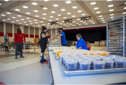 families pick up meals for scholars