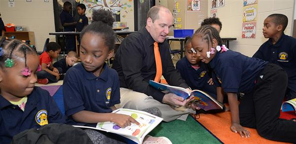 CEO reading with students