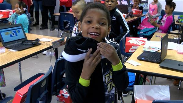 Imagine for Youth donates a new pair of Nikes for every student at Cleveland school