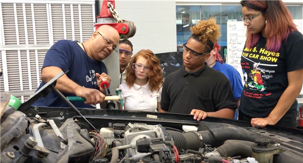 Students repair totaled police car, present it back to the City of Cleveland