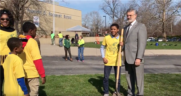 Mayor Frank Jackson poses with student for Arbor Day photo.