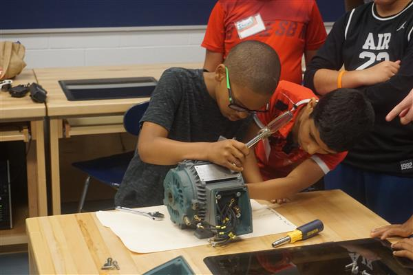 Kids learn nuts and bolts of manufacturing