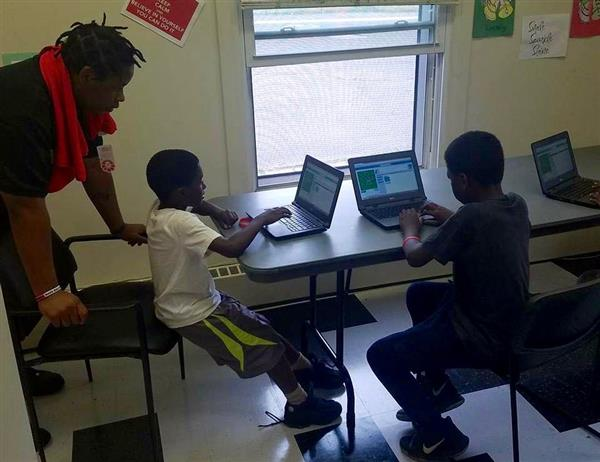 John Marshall IT students steer younger kids to coding (Photo Gallery)